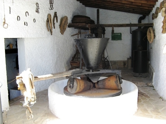 Roller mill for making virgin olive oil