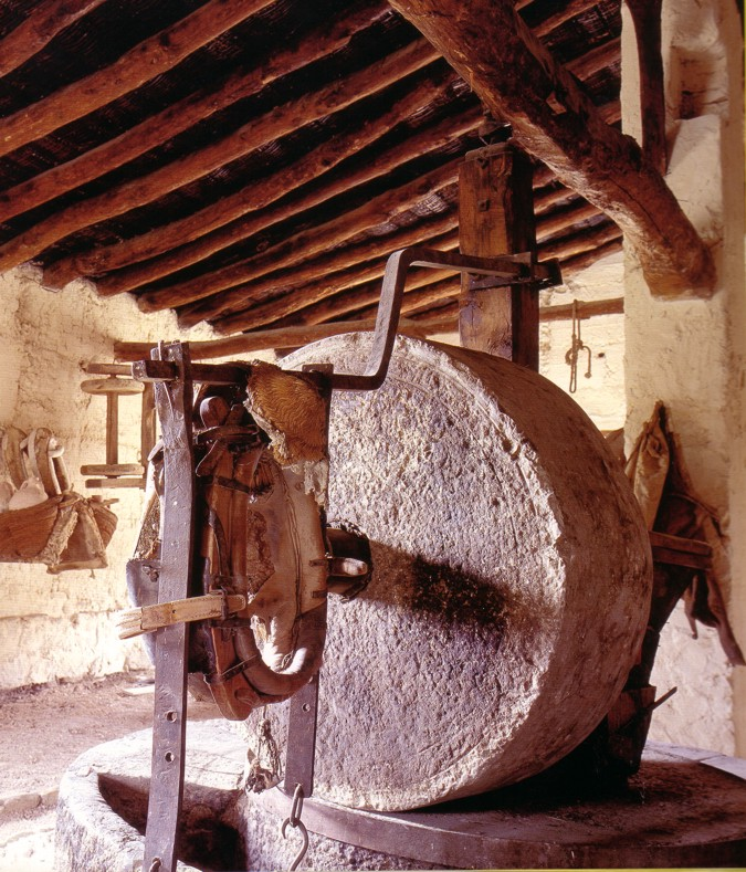 The stone mill is used in the traditional method for the elaboration of the olive oil