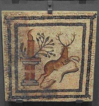 Calendario romano de Fraga con representación de olivo y aceitunas